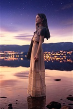 Preview iPhone wallpaper Girl standing in water, lake, city, starry, dusk
