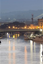 Preview iPhone wallpaper Italy, Abruzzo, city, evening, river, boats, lights, roads