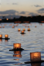Preview iPhone wallpaper Lanterns float on river surface