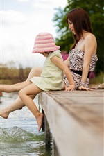 Preview iPhone wallpaper Little girl and her mother play water