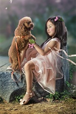 Lovely Asian little girl and dog, friends