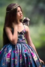 Lovely little girl, blue skirt, monkey