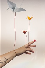 Preview iPhone wallpaper Paper cranes, flying, hand, creative picture