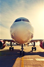 Preview iPhone wallpaper Passenger plane, front view, airport, runway, sunset