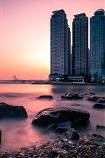 Preview iPhone wallpaper South Korea, Busan, Dongbaek Park, city, skyscrapers, stones, river, sunset