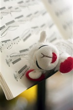 Preview iPhone wallpaper Toy sheep, music book