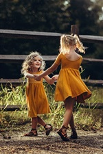 Preview iPhone wallpaper Two little girls, happy dance, grass, fence, summer