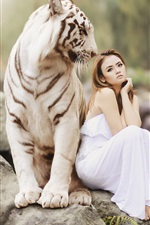 Preview iPhone wallpaper White tiger and Asian girl, sitting on stone, friendship
