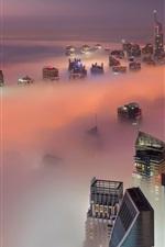 Preview iPhone wallpaper Dubai, UAE, skyscrapers, fog, clouds, morning