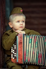 Preview iPhone wallpaper Little soldier, cute boy, accordion
