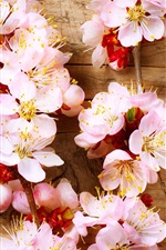 Preview iPhone wallpaper Pink peach flowers, wood board