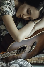 Preview iPhone wallpaper Sadness Asian girl and her guitar