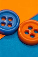 Dois botões, laranja e azul