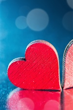 Two red love hearts, blue background, backlight