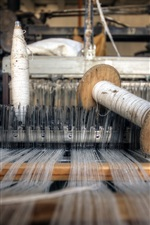 Preview iPhone wallpaper Weaving machine, threads