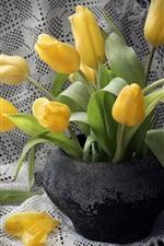 Yellow tulips, black vase