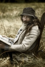 A man read book, glasses, hat, grass, chair
