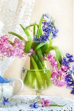 Blue and pink hyacinth flowers, lamp, curtain