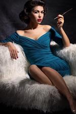 Blue skirt girl sit on sofa