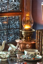 Books, lamp, tea, window