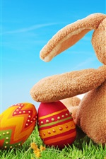 Preview iPhone wallpaper Colorful eggs, toy rabbit rear view, Easter