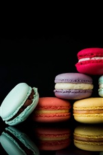 Preview iPhone wallpaper Colorful macarons, black background