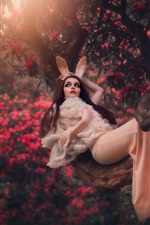 Preview iPhone wallpaper Girl, lying, tree, rabbit ears, flowers