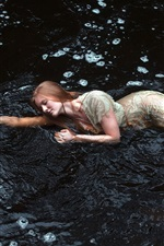 Girl sleeping in the water, stream