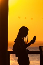 Preview iPhone wallpaper Girl use phone, silhouette, sunset