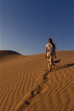 Preview iPhone wallpaper Girl walking in the desert, sands