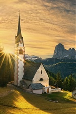 Italy, South Tyrol, Church, trees, mountains, sunset