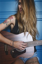 Long hair girl play guitar, tattoo