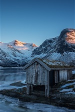 Preview iPhone wallpaper Norway, mountains, lake, snow, hut, evening, sunset