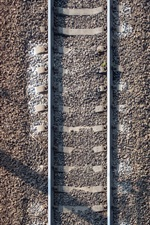 Preview iPhone wallpaper Railroad, stones, top view