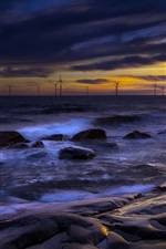 Preview iPhone wallpaper Sea, rocks, windmills, dusk