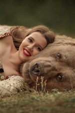 Smile girl and bear, rest on ground