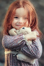 Preview iPhone wallpaper Smile little girl, red hair, toy