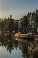 Preview iPhone wallpaper Amsterdam, Netherlands, river, boats, city, houses, trees, sun rays