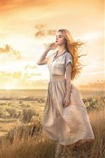 Preview iPhone wallpaper Beautiful blonde girl, grass, mountain, wind