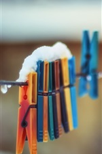 Preview iPhone wallpaper Clothespin, colorful, snow, rope