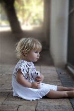 Preview iPhone wallpaper Cute baby girl, sit at street, fence