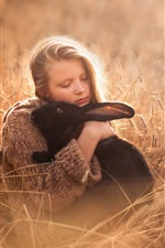 Preview iPhone wallpaper Cute girl and black rabbit, grass
