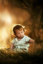 Preview iPhone wallpaper Cute little boy sit on grass ground, child