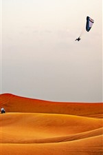 Preview iPhone wallpaper Desert, paragliding, extreme sport