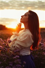 Girl side view, sunset, flowers