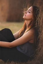 Preview iPhone wallpaper Girl sit on ground, bokeh
