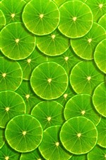 Preview iPhone wallpaper Green lemon slices background