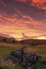 Preview iPhone wallpaper Hills, fence, red sky, clouds, sunset