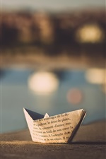 Paper boat, blurry background