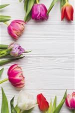 Pink, purple, white tulips, wood board